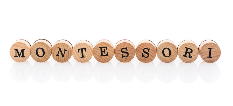 Word Montessori from circular wooden tiles with letters children toy.