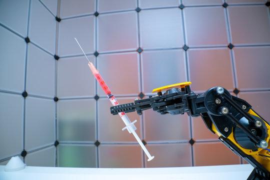 robot arm with medical syringe
