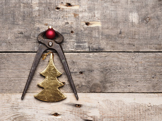 Old pliers with Christmas bauble