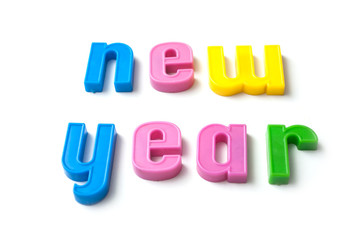 closeup of colorful plastic letters on white background - new year