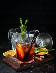 Negroni. Alcoholic cocktail. On a wooden background. Top view. Free copy space.