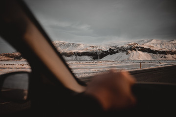 Anonymous people traveling by car in winter