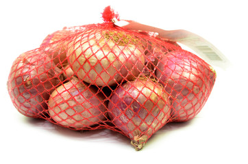 Pack of red onions isolated
