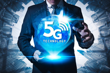 The abstract image of businessman using a smartphone overlay with 5g hologram. Element of this image furnished by Nasa. the concept of 5G, communication, network, connection, internet of things.