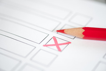 Close up voting bulletin with red pencil. Concept of election.