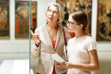 Woman and girl visiting museum