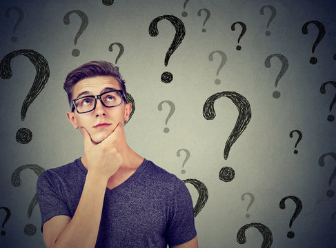 Thoughtful confused man has too many questions and no answer