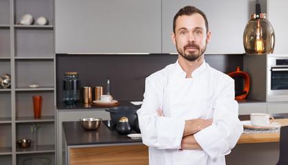 Confident chef in white coat