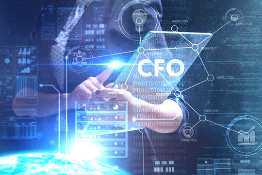The concept of business, technology, the Internet and the network. A young entrepreneur working on a virtual screen of the future and sees the inscription: CFO