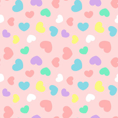 Colorful heart random size seamless pattern on pink background vector. Punchy pastel color, minimalist style.