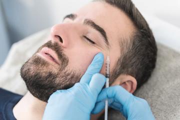 Man having facial procedure