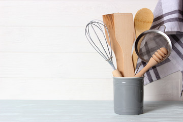set of kitchenware on wooden background. Cooking appliances.