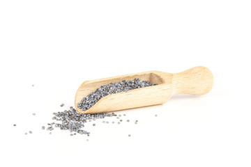 Lot of whole dry czech blue poppy seeds with wooden spoon isolated on white background