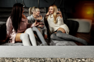 Table background of free space and three girls on sofa