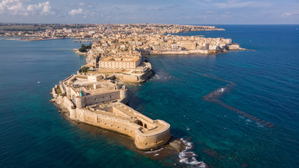 Aerial view of Ortigia, historical centre of the city of Syracuse. Aerial view of Maniace fortress in Ortigia, Sicily, Italy. Sanctuary