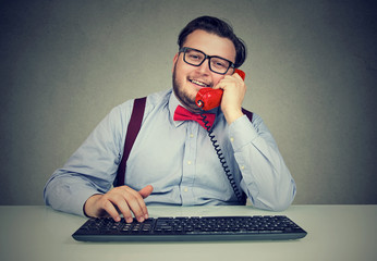 Chubby man working and speaking on phone