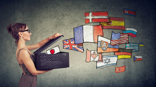 Woman speaks different languages opening a box with international flags flying away
