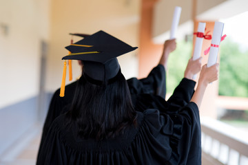 Black graduates wear black suits on graduation day at university.