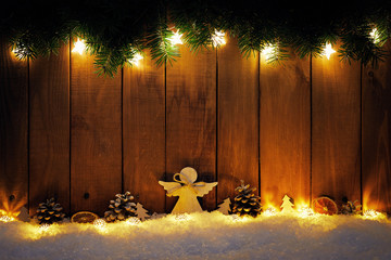 Christmas background with branches and decoration on dark wooden board