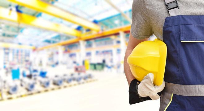 closeup work clothes of workers in a factory building // Berufsausbildung Technik in der Industrie - closeup Arbeitskleidung von Arbeiter in einer Fabrikhalle