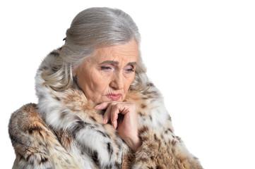 portrait of beautiful senior woman in fur coat