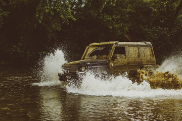 Expedition offroader. Drag racing car burns rubber. Mudding is off-roading through an area of wet mud or clay. Extreme. Off-road car. Mud and water splash in off the road racing.