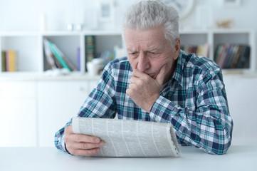 Senior man at homesenior man reading newspaper at home