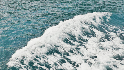 Foam wave of the sea surface from the movement of the ferry. View of the exciting sea of the Palawan Islands. Shooting in motion.