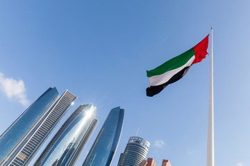 UAE flag waving in the sky, national symbol of UAE