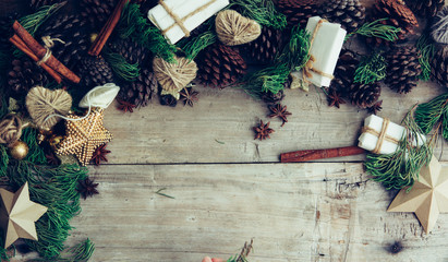 Christmas background with decorations and gift boxes on the wooden table.