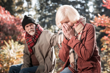 Depressed crying aged woman covering her face