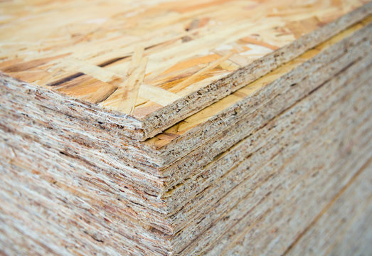 A stack of OSB sheets stacked one on another