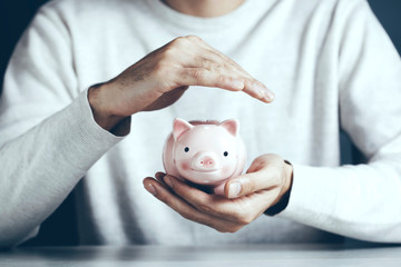 man hand piggy bank