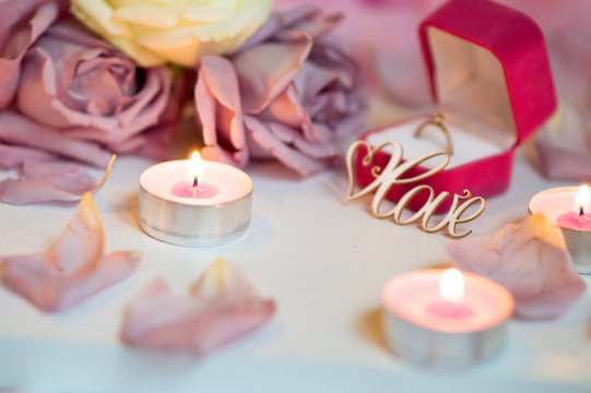 Valentine's Day Surprise.  Romantic evening with the beloved with rose petals on the bed and a ring for a marriage proposal on February 14
