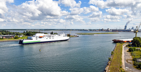The modern ferry enters the port of Rostock. The ferry line connects the German port of Rostock with Gedser in Denmark.