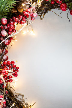 Christmas decoration on the left side of white background with lights