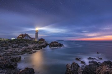 Night to day image of Portland Head Lighthouse at Cape Elizabeth, Maine
