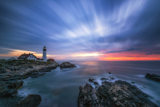 Cloud movement from a long exposure at dawn over Portland Head Lighthouse in Maine