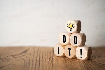 "Cubes with letters forming the message ""Do it!"""