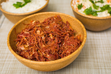 dried beef with rice and mayonnaise on the table