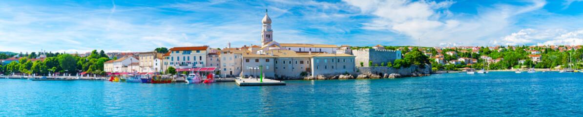 Wonderful romantic summer in old town at Adriatic sea. Summer panoramic coastline landscape. Boats and yachts in harbor. Krk. Krk island. Croatia. Europe.