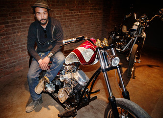 Portrait of hipster sitting on motorcycle