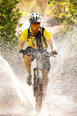 Smiling man cycling in water
