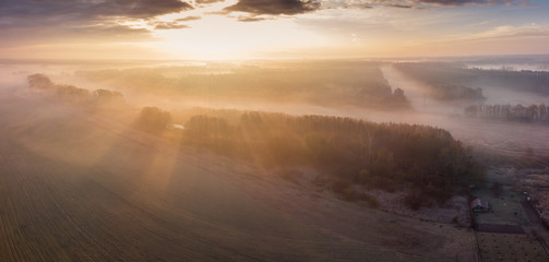 Autumn nature landscape above the ground with drone photography with sunlight and fog