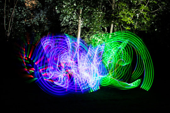 Colorful Light Painting Neon Motion effect.  Using a light up flashing kids sword with a long exposure at night.