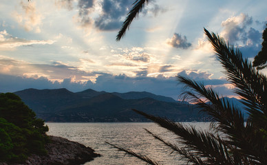 Beautiful sunset with golden rays breaking through clouds on a Mediterranean island