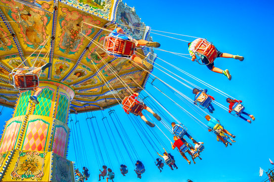 People enjoy an amusement park ride