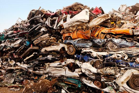 Stack of crushed cars at junkyard