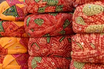 Rows of traditional Indian Rajasthani headwear, turbans or safa in Jaipur, Rajasthan / India.
