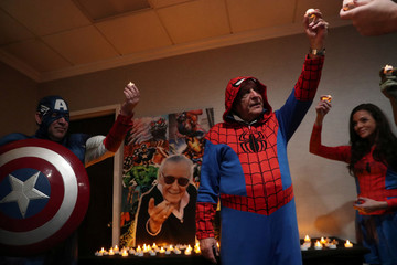 Fans of comic book icon Stan Lee, who passed away at the age of 95 on November 12, 2018, pay tribute during a vigil in Stony Brook, New York